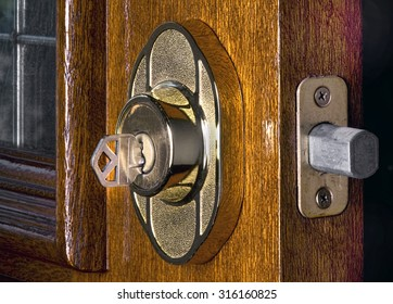 Deadbolt lock on mahogany front door.