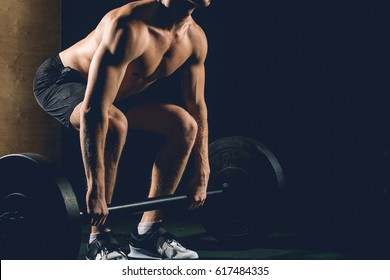 The Deadlift. Man Performing Heavy Deadlift In A Gym