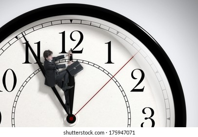 Deadline. Businessman trying to stop time. Time Management. Time pressure. Cure for old age. Front view.