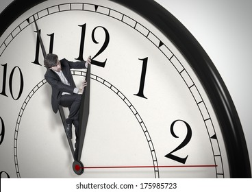 Deadline. Businessman trying to stop time. Time Management. Time pressure. Cure for old age. Perspective view.
