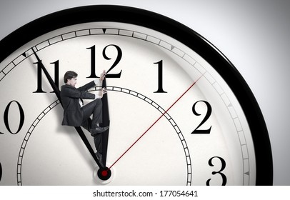 Deadline. Businessman trying to stop time. Time Management. Time pressure. Cure for old age. Annual reports. Front view.