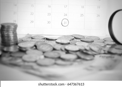 deadline calendar with some coin in foreground, overdue, reminder concept