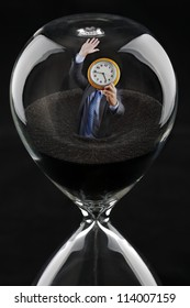 Deadline concept - businessman running out of time sinking into hourglass trying to beat the clock