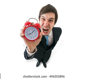 Deadline concept. Young crazy boss is yelling and holds clock in hand. Isolated on white concept.