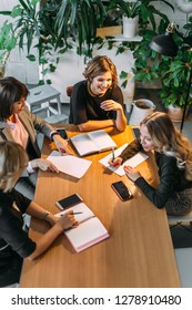 Deadline at Designer s Office. Attractive confident caucasian female Chief executive calls a late night meeting with her personal assistants at her office.