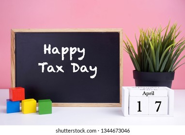The deadline to pay taxes April 15. Happy Tax Day words written on blackboard (Business Concept)