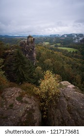 Deadpan dark misty fog mountains from viewpoint of Bastei in Saxon Switzerland, Germany to the mountains at sunrise in the morning fog, National park Saxon Switzerland.