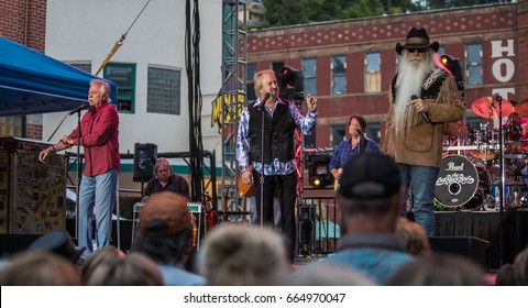 DEADWOOD, SD – JUNE 16.  Bonsall, Allen, and Golden of the Oak Ridge Boys performs on Main Street to a crowd of 8,000 fans during the Wild Bill Days in Deadwood, South Dakota – 16 June 2017