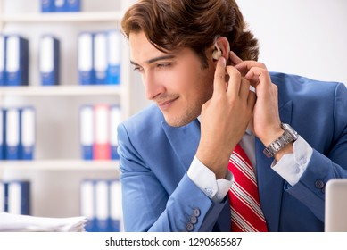 Deaf employee using hearing aid in office