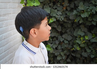 Deaf Kid smiling outdoors
