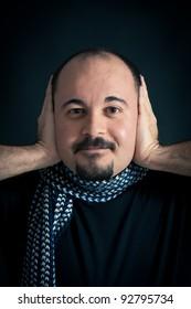 Deaf Man portrait on dark background.