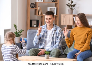 Deaf mute family using sign language at home