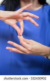 Deaf woman using sign language, close up