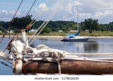 Deal Island, Maryland, USA - September, 2, 2018: A view of a skipjack sailing boat's boom and folded sails in the Deal Island Marina.