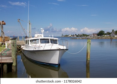 Deal Island, Maryland, USA - September, 2, 2018: A skipjack is moored in the Deal Island Marina ahead of the annual Skipjack Races and Festival.