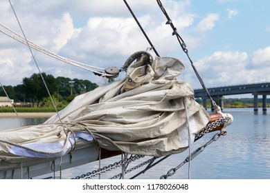 Deal Island, Maryland, USA - September, 2, 2018: A view of a skipjack sailing boat's boom and folded sails.