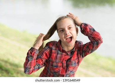 Deal with long hair on windy day. Windproof hairstyles. Girl little cute child enjoy walk on windy day nature background. Hairstyles to wear on windy days. Feeling cozy and comfortable on windy day.