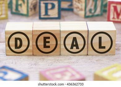 Deal word written on wood cube