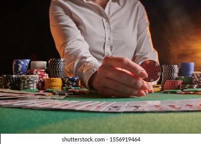 The dealer accepts bets at a casino, poker table, chips, dollars. Background for a casino gaming business