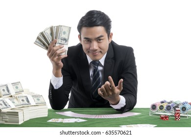 In the dealer man right hand shows a lot of banknotes And the left hand on the trigger finger to invite the gambler on white background with gambler casino concept