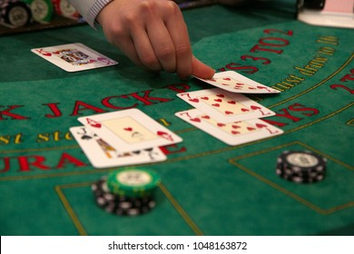 Dealer puts down a card on blackjack table