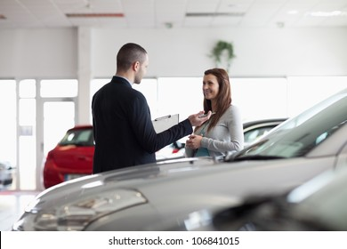 Dealer speaking with a client in a dealership