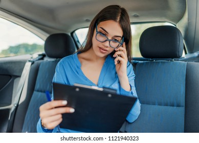 Dealing with work. Woman using smartphone in the car. Casual business ride. Portrait Of A Successful Businesswoman. Woman in car. Going to work