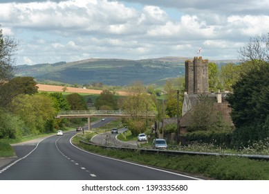 Dean Prior, South Devon, England, UK. May 2019. The A38 Devon Expressway and St George the Marty church overlooked by the Dartmoor National Park at Dean Prior.