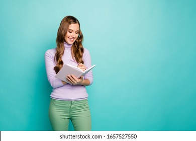 Dear diary. Photo of beautiful wavy lady hold planner write private secrets in journal inspiration moment wear lilac sweater pastel green trousers isolated teal color background
