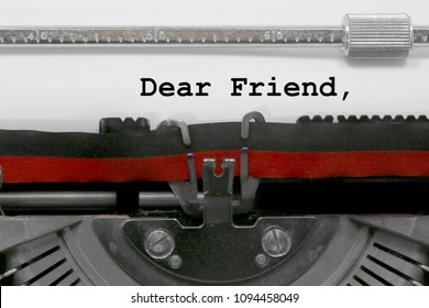 Dear friend text written by an old typewriter on white sheet
