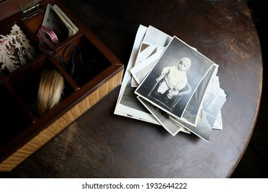 dear to heart memorabilia in an old wooden box, a stack of retro photos, vintage photographs of 1960, concept of family tree, genealogy, connection with ancestors
