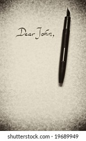 dear john letter being written in calligraphy on parchment paper with pen