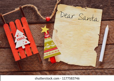 Dear Santa. Letter to Santa Claus with copyspace at decorated Christmas background.