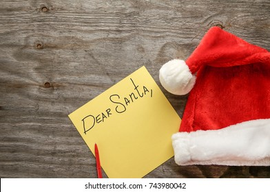 Dear Santa - letter to Santa Claus with copyspace over grunge wooden background