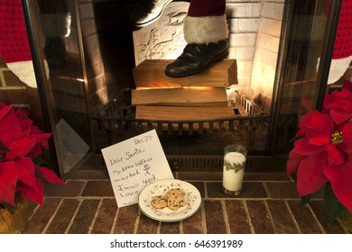 Dear Santa,  My little brother was bad and I was good.  A note waiting for Santa as he comes down the chimney Christmas Eve.  Santa comes down the chimney on Christmas Eve.