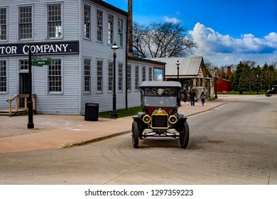 Dearborn, MI / USA - 04.21.2018 : Ford t model in the greenfield village next to the first old original rebuilt Ford Motor Company on sunny day