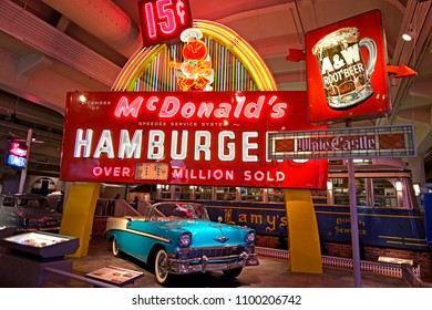 Dearborn, MI / USA - 04.22.2018: old  blue chevrolet bel air car with colorful Mcdonalds neon advertisement