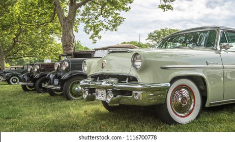 DEARBORN, MI/USA - JUNE 16, 2018: 4 vintage cars including a 1953 Mercury Monterey at The Henry Ford (THF) Motor Muster car show, held at Greenfield Village, near Detroit, Michigan.