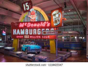 DEARBORN, MI/USA - JUNE 16, 2018: A 1956 Chevrolet BelAir car and McDonalds, A&W Root Beer, White Castle and Lamy's Diner neon signs at The Henry Ford (THF), near Detroit, Michigan.