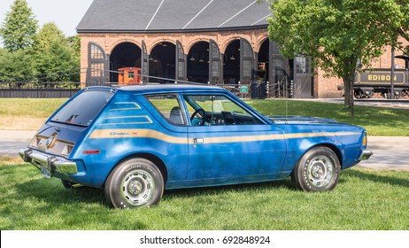 DEARBORN, MI/USA - JUNE 17, 2017: A 1973 American Motors Gremlin X car at The Henry Ford (THF) Motor Muster car show, held at Greenfield Village, near Detroit, Michigan.