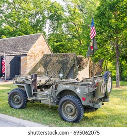 DEARBORN, MI/USA - JUNE 17, 2017: A 1940s Military Police Jeep at The Henry Ford (THF) Motor Muster car show, held at Greenfield Village, near Detroit, Michigan.