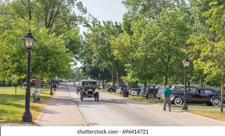 DEARBORN, MI/USA - JUNE 17, 2017: Driving vintage cars at The Henry Ford (THF) Motor Muster car show, held at Greenfield Village, near Detroit, Michigan.