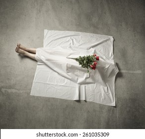 death body under white cloth