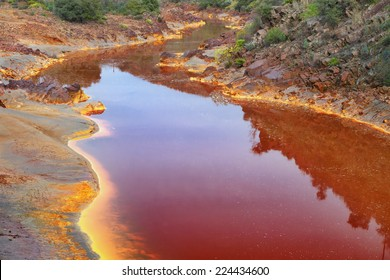Death and desolation in the Tinto River, Huelva, Spain. As a possible result of the mining, Rio Tinto is notable for being very acidic and its deep reddish hue is due to iron and copper.