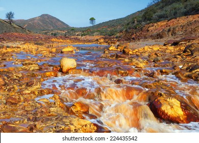 Death and desolation in the Tinto River, Huelva, Spain. As a possible result of the mining, Rio Tinto is notable for being very acidic and its deep reddish hue is due to iron and copper dissolved.