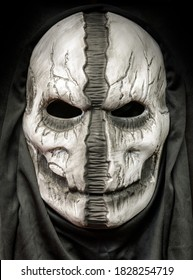 Death Hood Mask With Face Ripped Down The Middle Isolated on Black Background
