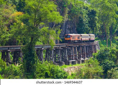 Death Railway, Thai Railway,World war II historic railway, known as the Death Railway with a lot of tourists on the train taking photos of beautiful views over Kwai Noi River