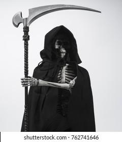Death with scythe black and white arm across body