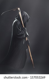 death with scythe fliesin the fog at night