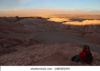 Death Valley, Atacama Desert, Chile - July 22nd, 2013: Beautiful red sunset in the Andean mountains in the Atacama Desert.